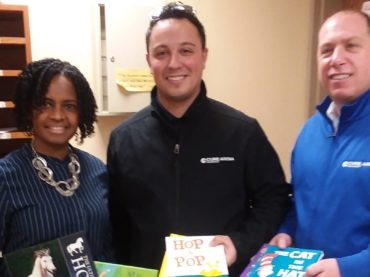 NJEA partners with Cure Insurance Arena to distribute books to local school