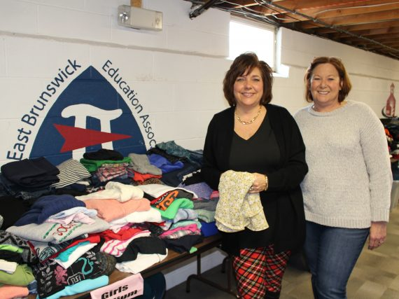 East Brunswick EA Bear's Den clothes families in dignity