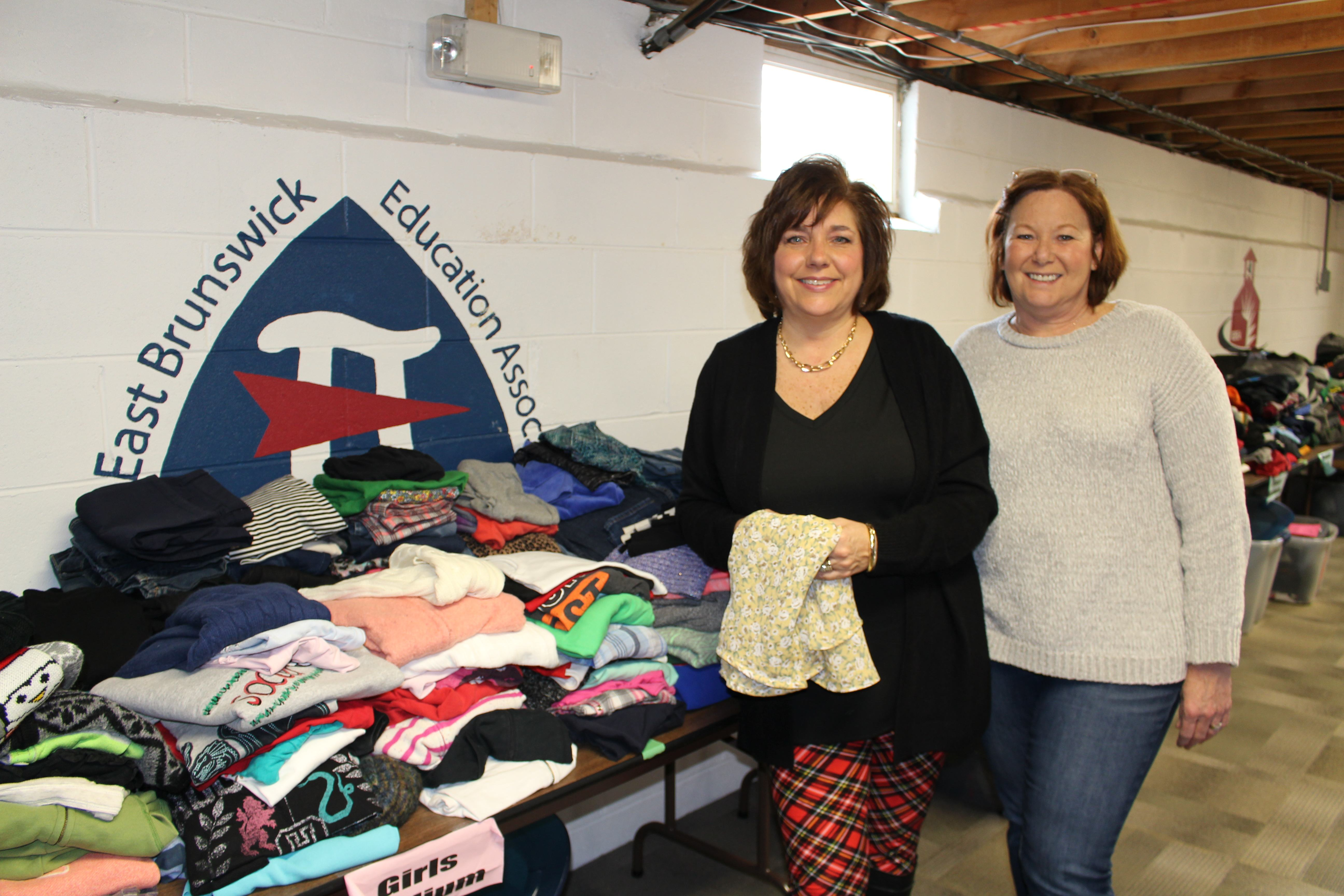 a0c50c22af2 EBEA President Dana Zimbicki and EBEA member JoAnn Peterson sort clothing  in The Bear s Den
