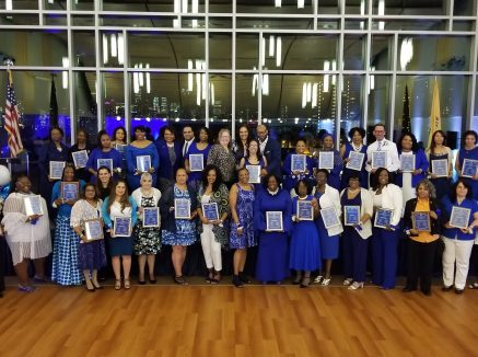 Jersey City paraprofessionals walk the 'blue and white' carpet!